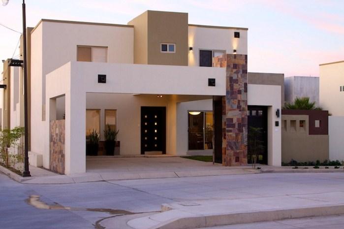 Fachadas con muros de cantera for Fachadas exteriores de casas modernas