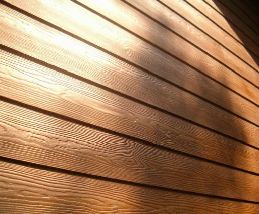 el siding eternit es un revestimiento de gran durabilidad constituido por tablas de cemento con una textura de madera de cedro en la cara externa - Revestimiento Exterior